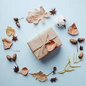Handmade paper gift box with dried leaves decor