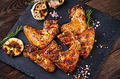 Tasty spiced grilled chicken wings. Beer snack