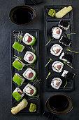 Seafood delicatessen sushi rolls set on plates