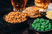 Appetizing snacks with two mugs of light beer
