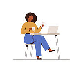 Black Woman chatting on a smartphone sitting at the cafe table. Happy freelancer or office female working remotely use a laptop.