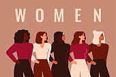 Strong five women and girls of different nationalities and cultures stand together. Union of feminists or sisterhood. Concept of gender equality and female empowerment movement.