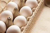 white fresh eggs in a box, close up view