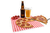 a pizza spatula holding a slice of pepperoni pizza with a bottle and a glass of beer isolated on white