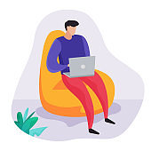 Man with computer sitting in bean bag