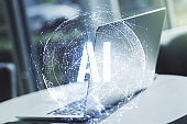 Creative artificial Intelligence symbol concept with modern computer on background. Double exposure