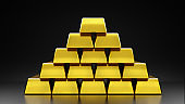 Pure gold laying on a black background The concept of economic value of gold trading in the stock market
