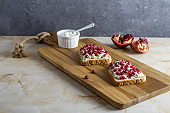 Sandwiches with cottage cheese and pomegranate