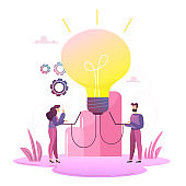 Business concept for launching ideas, light bulb is shining. Tiny little men launch an idea, light bulb is shining appears an idea, a symbol of creativity, ideas, mind, thinking.