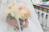 This is wedding bouquet at bride's hands.