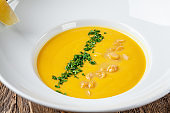 Serbian cuisine. Macedonian cream soup of chickpeas, carrots, onions, garlic, with chicken. Serving dishes in a restaurant in a white plate. background image, copy space text