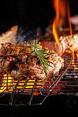 Chef cook fries meat, beef steak on an open fire in a restaurant. background image, copy space text