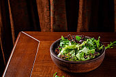 Raw food concept. A plate with fresh salad is on the table. background image, copy space text