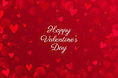 Red Valentine's day background with hearts. Bokeh Valentines day backdrop