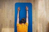 Young woman doing yoga at living room.