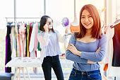 young new SME business owner happy and successful teen portrait with fashion clothing shop background