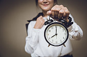 Business time clock or working hours morning times remind alert warning concept, People holding retro bell alarm clock.
