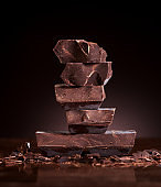 Chopped chocolate on a dark marble background