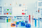 Glass flask in Science Chemical laboratory or Medical research lab with colorful liquid for background