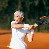 Active Lifestyle Seniors – Positive Mature Woman Playing Tennis Recreationally