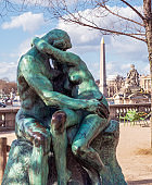 Bronze statue The Kiss by Auguste Rodin in the Tuileries Garden - Paris