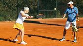 Active Senior Woman Practicing Tennis