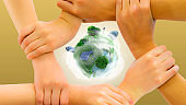 People protect earth concept, many hands together to protect sustainable globe