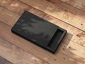 Black sliding gift box Mockup on wooden table outdoor