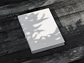 White diary Mockup with textured hardcover on black table outdoor