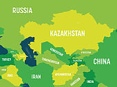 Central Asia map - green hue colored on dark background. High detailed political map of central asian region with country, capital, ocean and sea names labeling