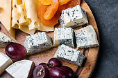 assorted cheeses with mold, Maasdam, Roquefort, brie and others