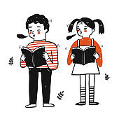 Young students boy and girl holding book