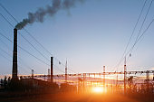 Thermal power stations and power lines during sunset.