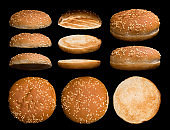 Big set of burger bun isolated on black background. Different sides and parts