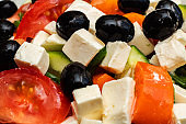 Cucumbers, tomatoes and cheese in a salad closeup