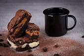 Chocolate brownie with delicious filling. Closeup photography.