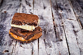 Chocolate brownie with milk powder delicious filling. Closeup photography.