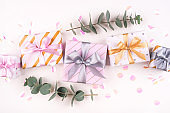 Set of gift boxes with bows and confetti on a white background.