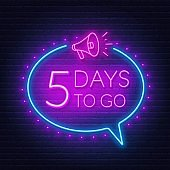 Five days to go neon sign on brick wall background.