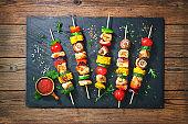 Chicken kebabs on skewers with mushrooms and vegetables
