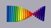 Group of rainbow cylinders rotating. Gray background. Abstract illustration, 3d render.