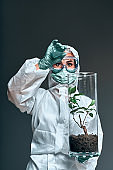 Medium shot of biologist working with plant incubators in a lab of a Mars base