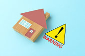 Warning sign and house object on light blue background