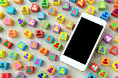 Smart phone and colorful blocks with human pictogram