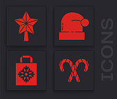 Set Christmas candy cane with stripes, Christmas star, Christmas Santa Claus hat and Christmas paper shopping bag icon. Vector