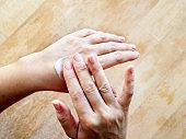 Woman hand hydrating skin applying cream