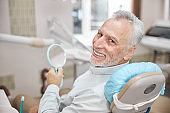Aging man looking contented with his dental appointment