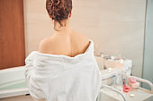 Brunette woman staying alone in the bathroom