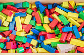 Playing with wooden toy blocks in kindergarten or preschool