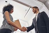 Two smiling business people greeting each other